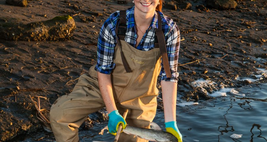 Sam with a fish in the field