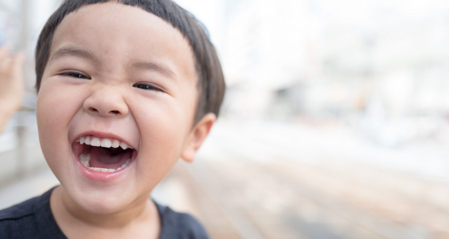 A little boy smiling with an open mouth