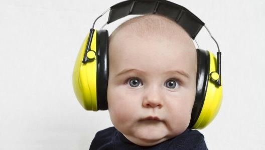 Baby wearing hearing PPE (ear muffs)