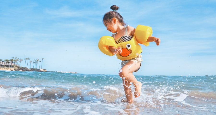 Kid having fun on the beach shore