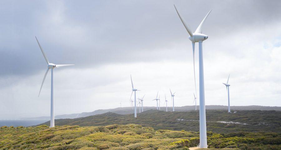 Wind farm on a green mountain terrain
