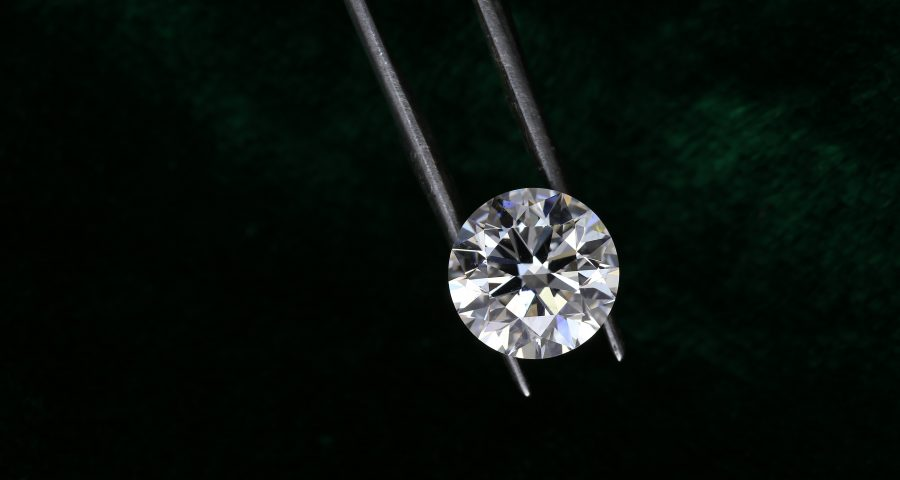 Diamond hold by a tweezer