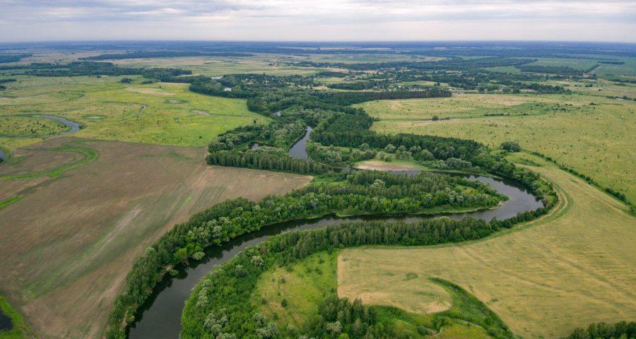 River crossing green land fields