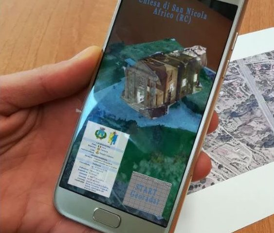 Smartphone with the augmented reality app opened showing how a church looked like in the past