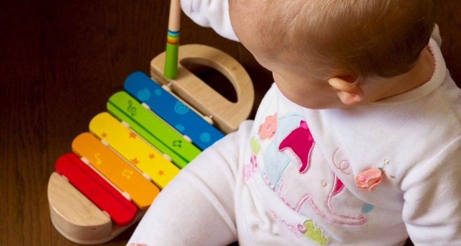 Baby playing a colorful xylophone