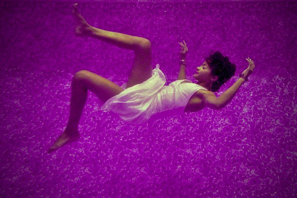 Woman falling in purple haze.