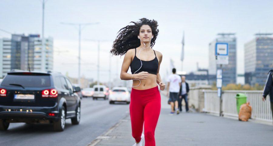 Image of woman running on street.