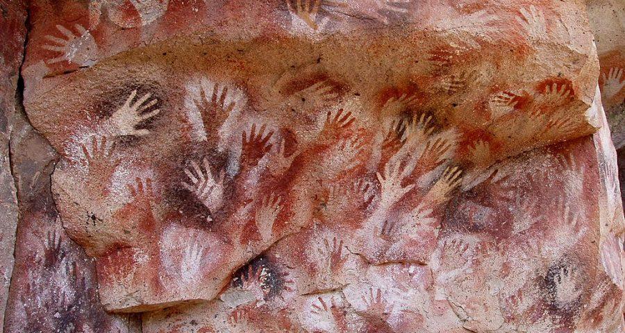 Ancient art showing hand prints at the Cuevas de las Manos upon Río Pinturas, near the town of Perito Moreno in Santa Cruz Province, Argentina.