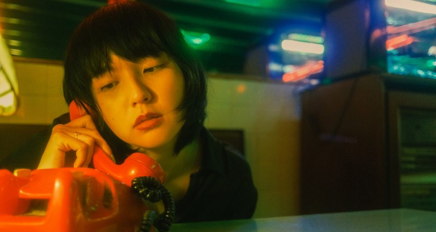 Image of young Asian woman on phone call.