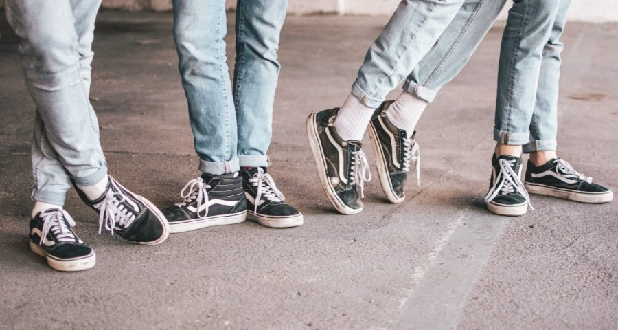 Four young people in sneakers. Photo by Ben Weber on Unsplash.